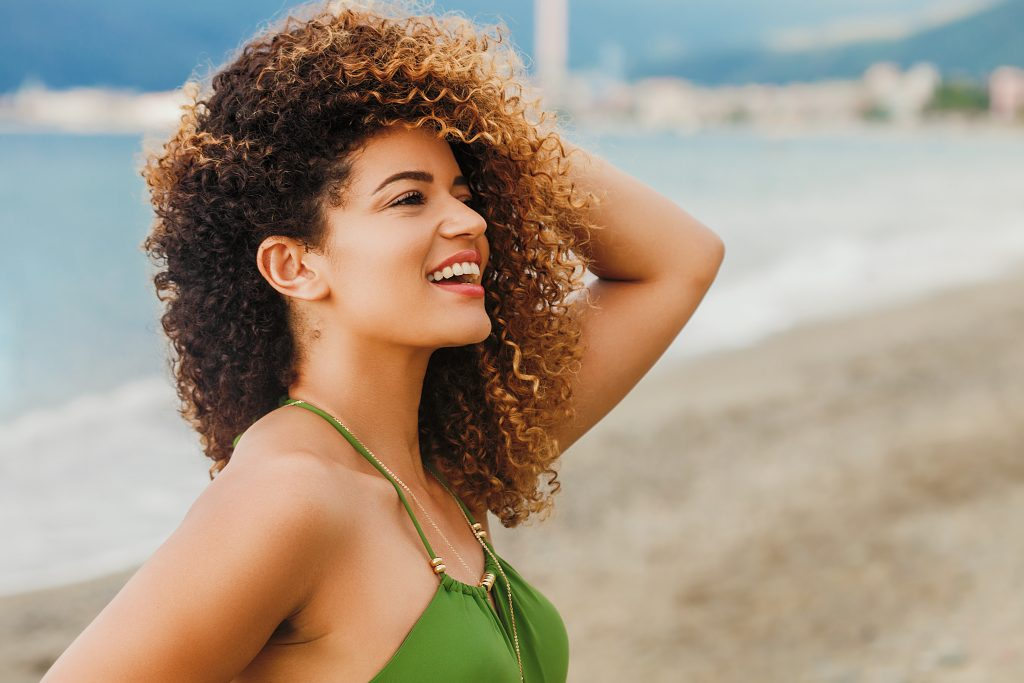 woman portrait smiling on the beach
