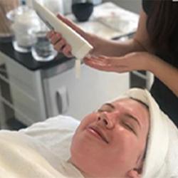 patient receiving facial
