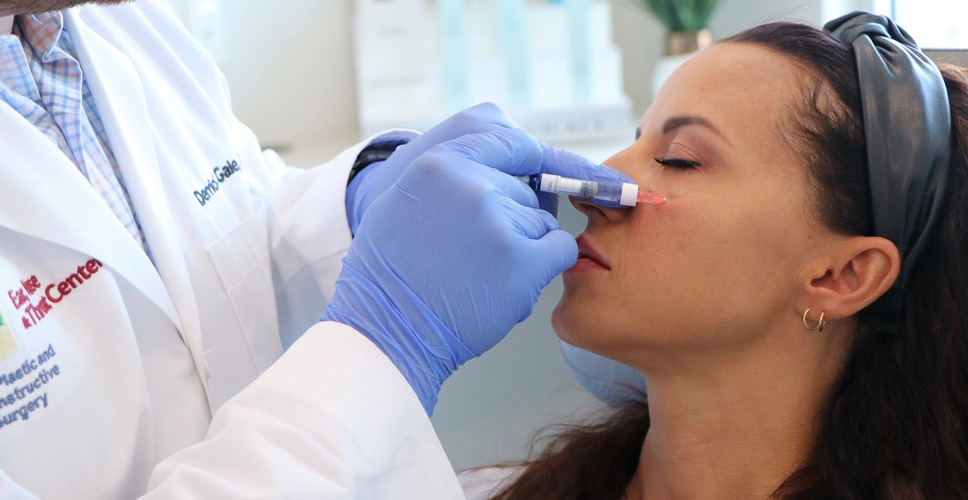 Dr. Gale applying Dermal Fillers to patient