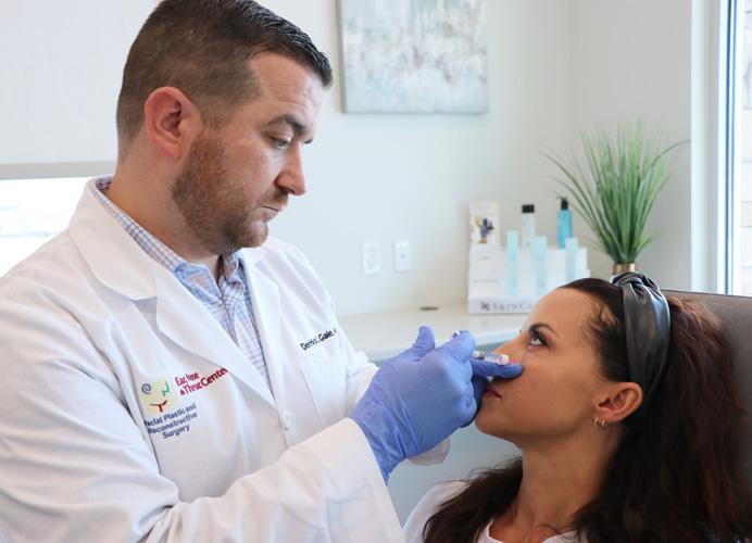 Dr. Gale applying Dermal Fillers