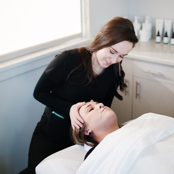 Aesthetician with patient